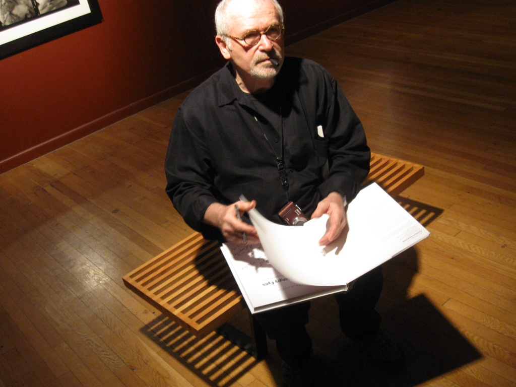 Abe Franjdlich signing Mort Epstein's copy of Penelope's eyes