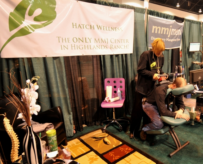 MMJ Provider Hatch Wellness providing back massages at KushCon2, Denver, Colorado