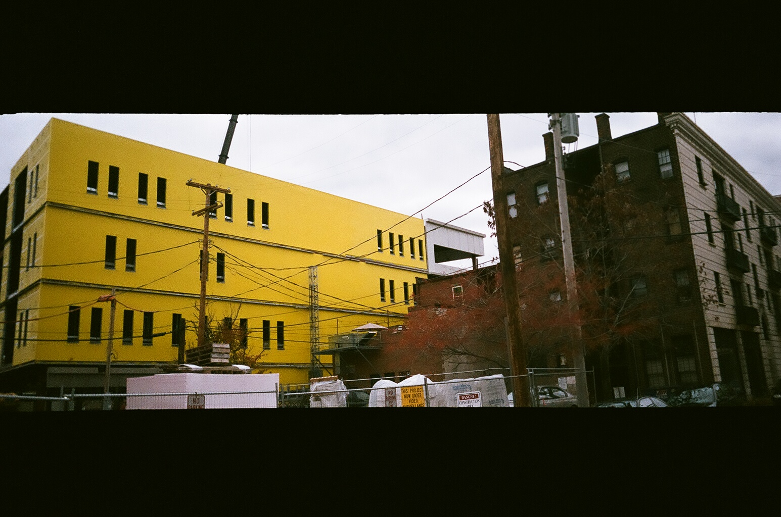 Big yellow building next to Euclid Tavern