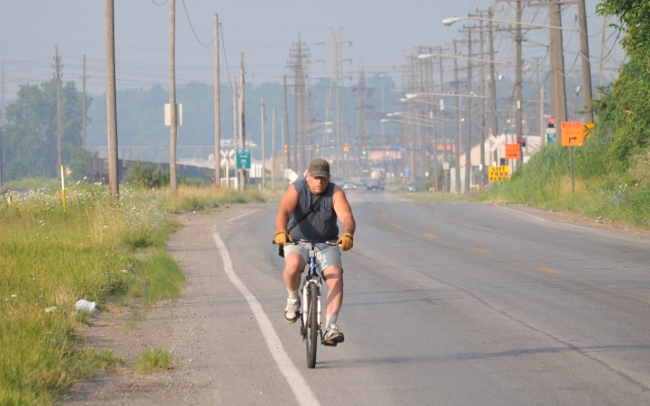 Bicyclist in Cleveland Flats during unhealthy smog conditions