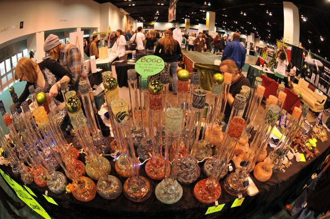 Colorful display of glass bongs at Kushcon Convention Denver