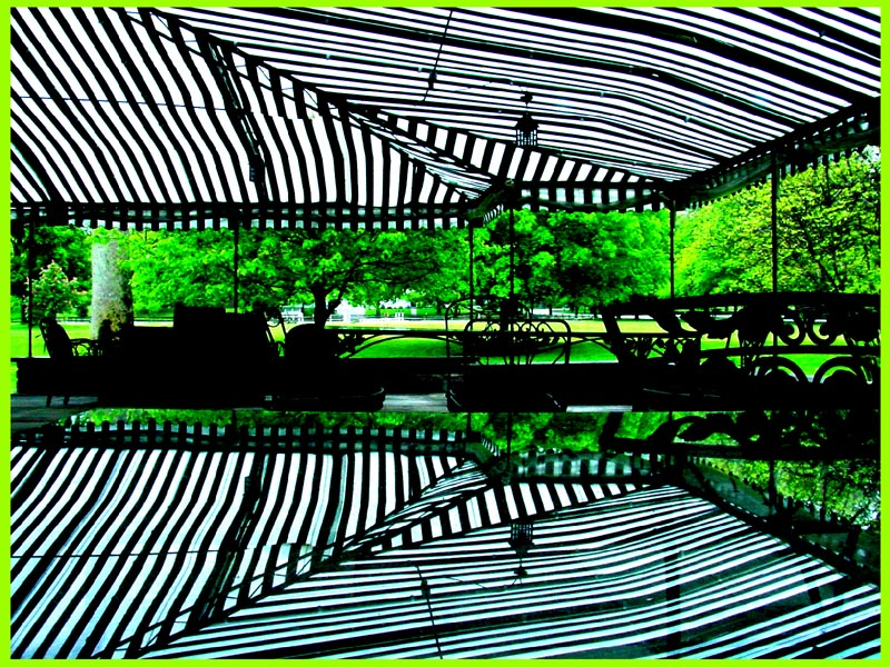 Hunt Club Chagrin patio awning reflected in glass table top image jeff buster