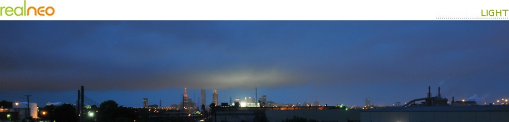 Cleveland skyline in storm with clouds illuminated by Progressive Field