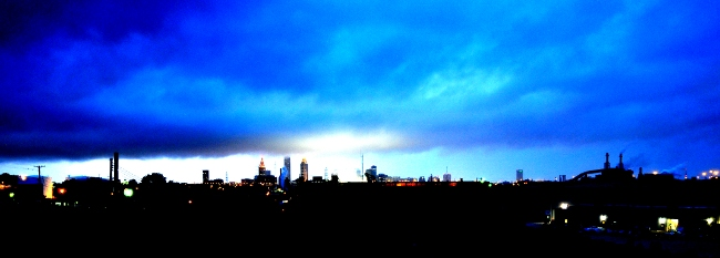 Cleveland skyline illuminated by Progressive Field and lightning