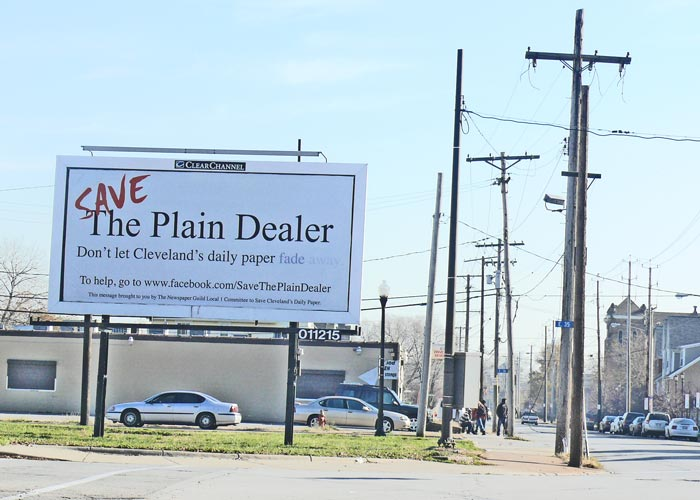 plain dealer newspaper fade away layoff cleveland ohio billboard campaign