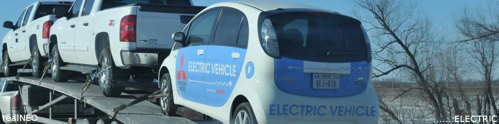 realNEO Electrib Header featuring first Mitsubishi electic car model shown in America