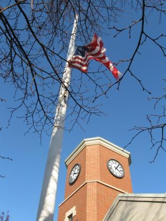 Flag half mast and tattered
