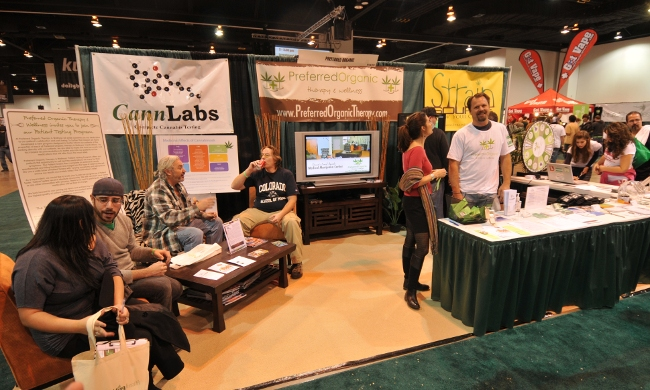 KushCon2 vendors in this one booth include a testing lab, MMJ dispensary, and producer of MMJ granola