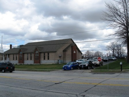 Parishioners leaving a suburban church by car en masse