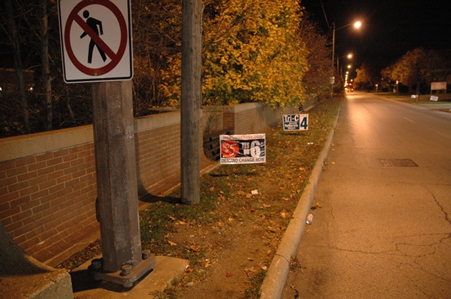 Illegal Issue 6 and Issue 4 signs at RTA property in Shaker Boulevard in Cleveland