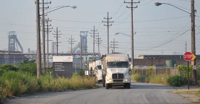 Trucks hauling waste from Mittal Cleveland WOrks steel plant in Cleveland Flats