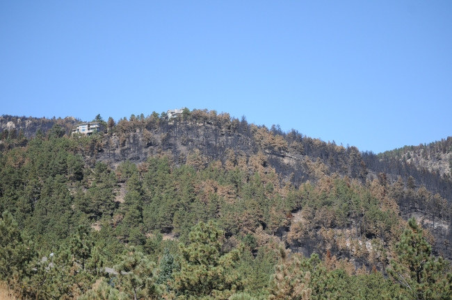 Fourmile Canyon Wildfire, West of Boulder, Colorado, September 2010 - blessed housed spared from fire at door