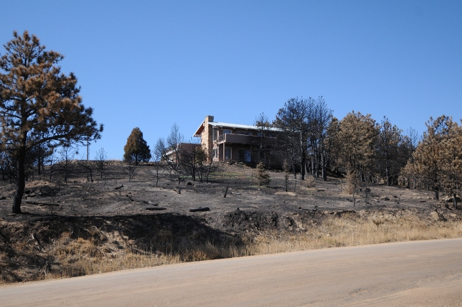 Fourmile Canyon Wildfire, West of Boulder, Colorado, September 2010 - home spared surrounded by ashes
