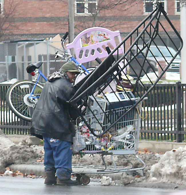 Image 12.30.10 jeff buster on Woodland near E55 in Cleveland Ohio scrap collector with shopping cart