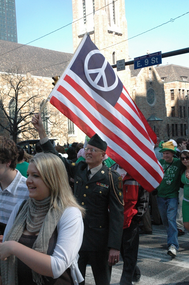 Lou Pumphrey in uniform carrying Flag of Peace in 2009 St. Patrick's Day Parade