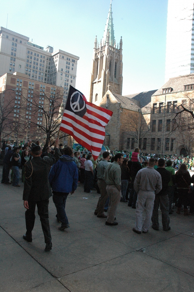 Lou Pumphrey in uniform with Peace Flag marching in 2009 Cleveland St. Patrick's Day Parade