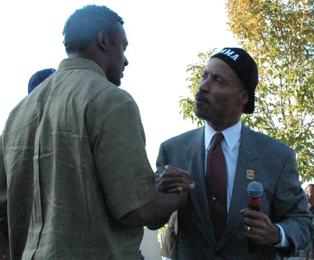 Cuyahoga County Commissioner Peter Lawson Jones Greeting Cleveland Browns Pro-Bowl Linebacker Willie McGinest