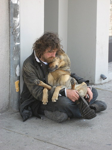 homeless_man_ cuddling_dog.jpg