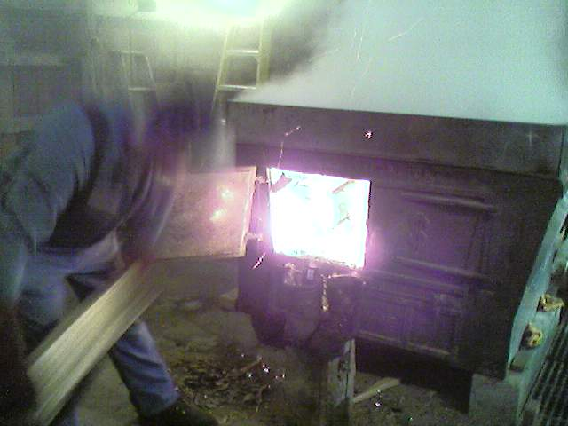 stoking the fire in the sugar house