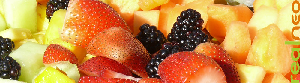 summer berry and melon fruit salad in sunlight
