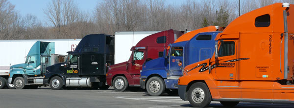 tractor trailers at rest stop image jeff buster