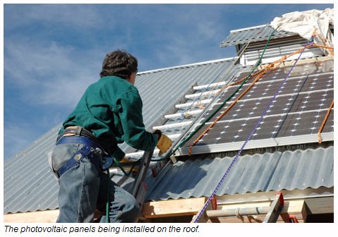 PV Panels Being Installes On A Workshed Roof