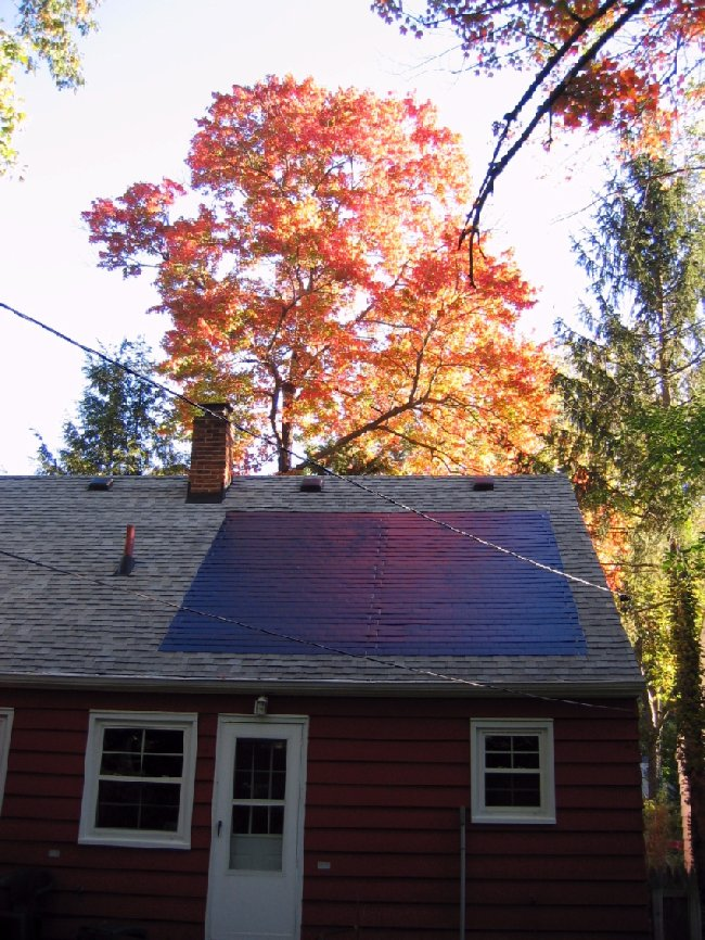 Small house with solar roofing shingles