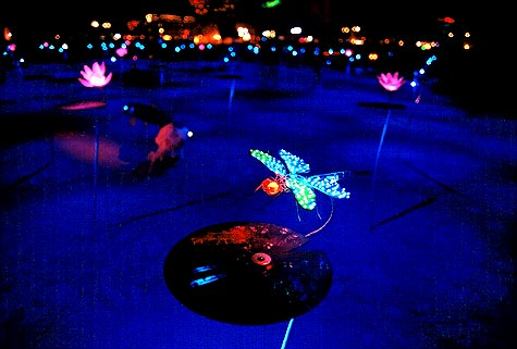 LED lighted dragonfly above metal lillypad