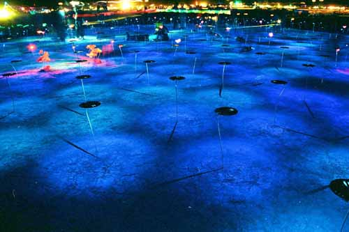 Closer view of blue lighted desert area
